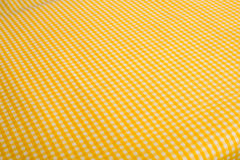 Yellow Gingham Background. Yellow Gingham or checked tablecloth background Stock Images