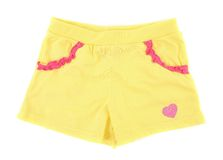 Yellow girl shorts with heart. Stock Image