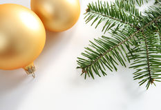 Yellow glass balls and some fir Royalty Free Stock Photos