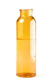 Yellow glass bottle Stock Image