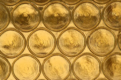 Yellow glass circles, background. I found this beautiful glass pattern on a seperating door between rooms of a hotel. It is very bright and shiny, and can be Royalty Free Stock Photos