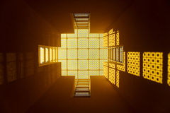 Yellow Glass Window. Looking up at a yellow glass roof Royalty Free Stock Image