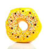 A yellow glazed donut Stock Images