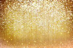 Yellow glitter golden holiday background. With stars, blurred light effect Royalty Free Stock Images