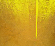 Yellow gloss paint plaster background Royalty Free Stock Images