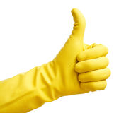 Yellow glove. Thumbs up with a yellow vinyl glove Royalty Free Stock Images