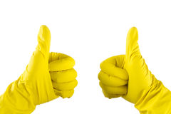 Yellow glove for cleaning on womans arm show thumbs up Stock Image