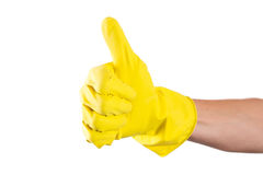 Yellow glove for cleaning on womans arm show thumbs up Royalty Free Stock Images