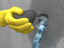 Yellow-gloved hand put extra-rapid cement in hole. Yellow-gloved hand put the plug (extra-rapid cement) in the hole with streaming water Stock Photos