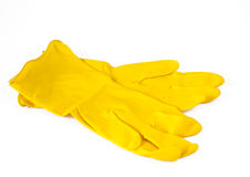 Yellow gloves. On white background royalty free stock photography