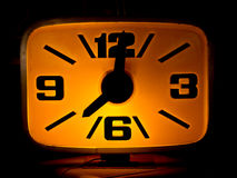 Yellow glow clock. in coffee shop. Stock Photos