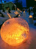 Yellow glowing ice on a pedestal royalty free stock photo