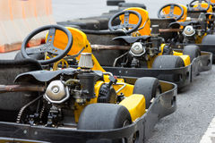 Yellow Go-kart in perspective row Royalty Free Stock Images