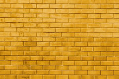 Yellow gold brick wall abstract texture background Royalty Free Stock Photography