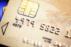 Yellow gold credit card close up Stock Images