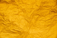 Yellow gold  crumpled  paper abstract for texture background Stock Images