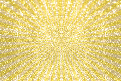 Yellow and gold glitter bokeh on star burst background Stock Image