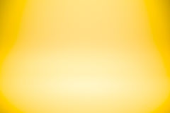Yellow gold gradient abstract studio wall for backdrop design product or text over. Yellow gold gradient abstract studio wall for backdrop design for product or Stock Photo