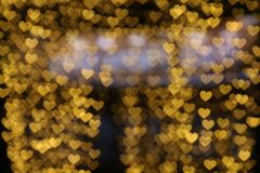 Yellow gold heart-shaped hanging valentine background Colorful lighting bokeh white for decoration night backdrop wallpaper blurre. D valentine, Love Pictures Royalty Free Stock Photo