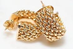 Yellow gold hoop earrings stock image