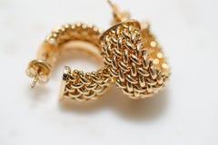 Yellow gold hoop earrings royalty free stock image