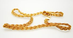 Yellow gold jewelry Stock Images