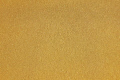 Yellow gold paint with glittering flakes Stock Images
