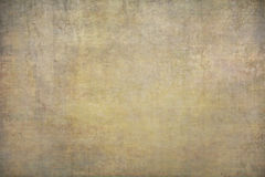 Yellow, gold painted canvas or muslin backdrop Royalty Free Stock Photos