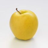 Yellow gold pple on white background. An apple on white background Royalty Free Stock Photos