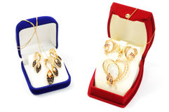 Yellow gold sets. In open boxs, on white background Royalty Free Stock Image