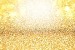 Yellow Gold Sparkle Glitter Abstract Background. Can Be Used As Backdrop in Photo Studio or Product Placement royalty free stock photo