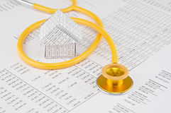Yellow and gold stethoscope coil house Stock Images