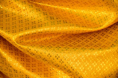 Yellow Gold Thai Fabric woven background Texture Stock Image