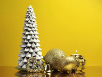Yellow gold theme Christmas gift and bauble decorations royalty free stock photography