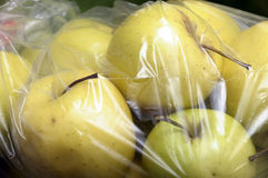 Yellow Golden Apples packed in plastic film Royalty Free Stock Image