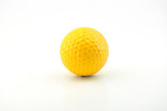 A yellow golf ball. Isolated on white background Royalty Free Stock Images