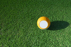 Yellow golf. Yellow golf ball on green grass Stock Image