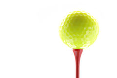 Yellow golf ball and tee isolated Stock Photography