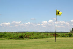 Yellow golf flag Royalty Free Stock Photos