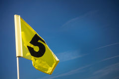 Yellow golf flag Stock Image