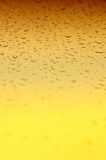 Yellow gradient water drops background Royalty Free Stock Photography
