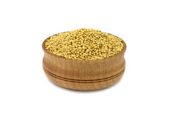 Yellow grain mustard in a wooden bowl Royalty Free Stock Photography