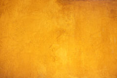 Yellow grainy wall surface texture for background Stock Photos