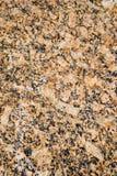Yellow granite. Textured yellow granite stone background Stock Image