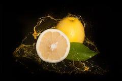 Yellow Grapefruit Inside Juice Splash Stock Photo
