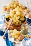 Yellow grapes and honey Royalty Free Stock Photography