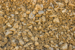 Yellow gravel for roads at construction site Royalty Free Stock Image