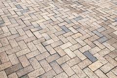 Yellow gray cobblestone road pavement. Background photo texture Stock Image