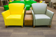 Yellow and gray leather sofa with side wooden table Royalty Free Stock Photo