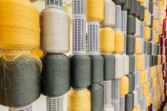 Yellow and gray silk thread in spool Stock Images